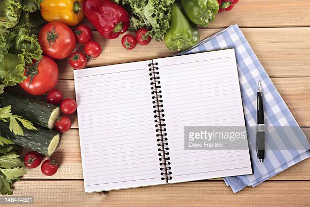 Summer salad ingredients and a recipe book
