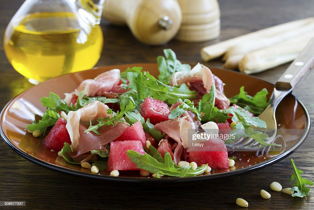 Summer salad with water-melon and prosciutto. : Stock Photo