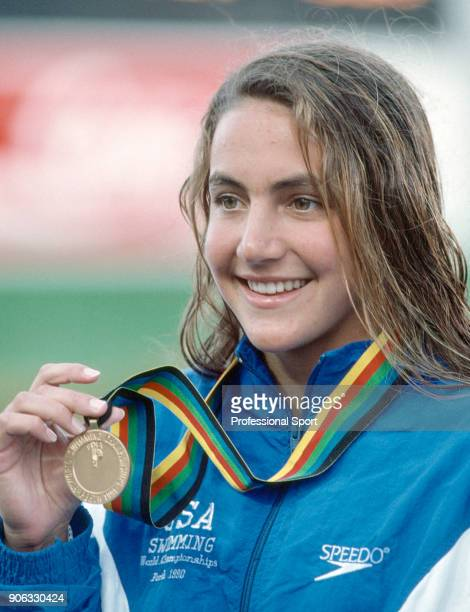 Summer Sanders of the USA with her gold medal for the women's 200 metre butterfly at the World Aquatic Championships in Perth Australia circa January...