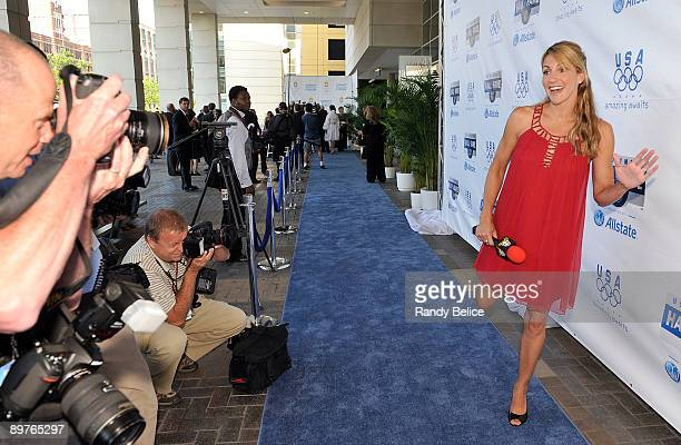 Summer Sanders Olympic medalist NBC Sports television personality and event co host poses for photographers covering arrivals to the 2009 US Olympic...