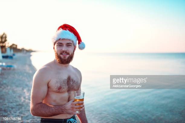 Summer Santa With Glass Of Beer On The Beach