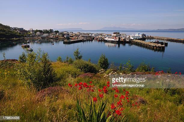 Summer scene in Mallaig Harbour with the distant islands of Eigg and Rum in view West Highlands Scotland United Kingdom