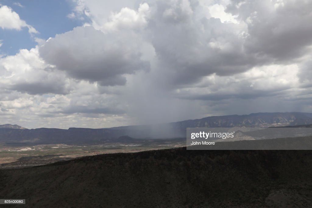 A summer shower falls in the west Texas Big Bend region long the U.S.-Mexico border on August 1, 2017 as seen from a U.S. Customs and Border Protection helicopter near Lajitas, Texas. Logistical challenges, such as the rugged terrain of Big Bend are just some of the complications facing the construction of a border wall proposed by President Trump.