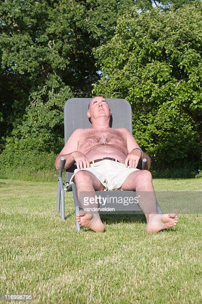 summer snooze - hairy man chest stock photos and pictures