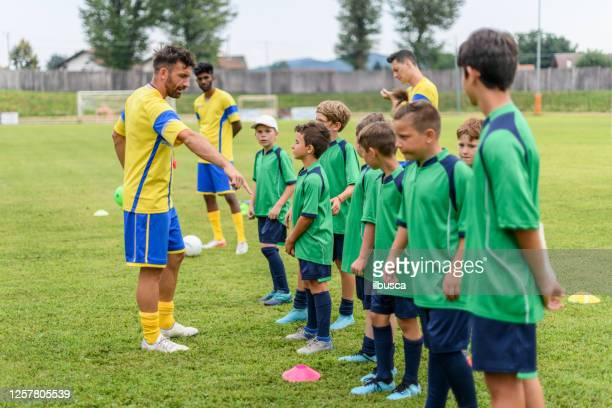 summer soccer football camp school for children, training. - sports training camp stock pictures, royalty-free photos & images