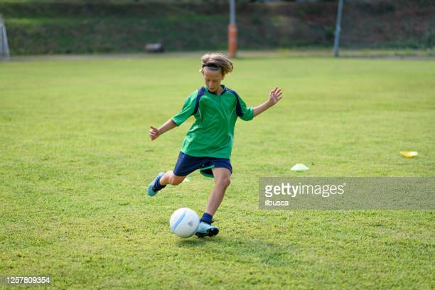summer soccer football camp school for children, training. - kicking stock pictures, royalty-free photos & images