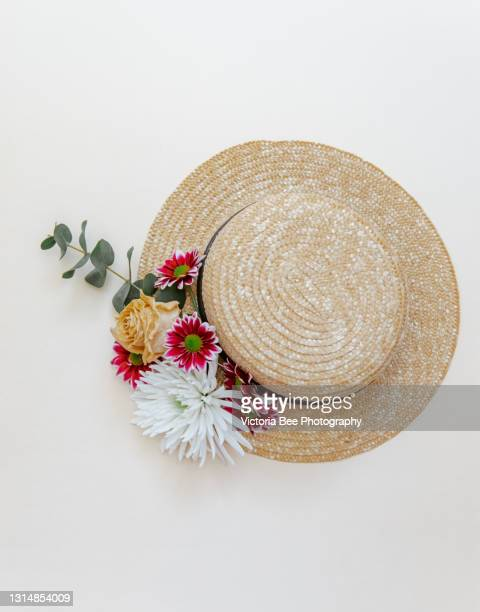summer, spring concept, straw braided hat with flowers - straw hat stock pictures, royalty-free photos & images