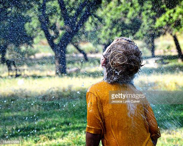 summer sprinkler fun - lynn pleasant stock pictures, royalty-free photos & images