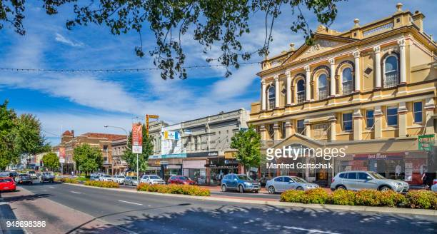 summer street with the prominent 19th century palmers building, orange, central west new south wales - orange stock pictures, royalty-free photos & images