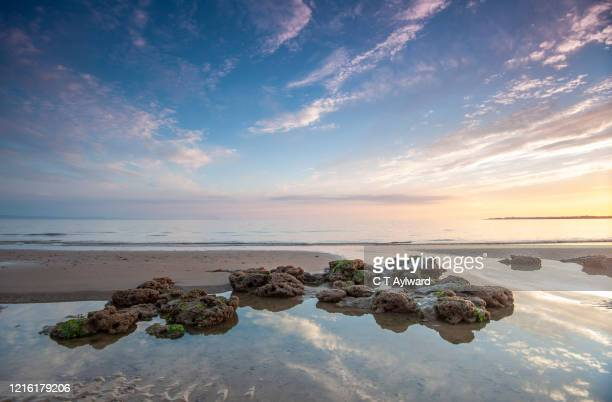 summer sunset on the welsh coast - porthcawl stock pictures, royalty-free photos & images
