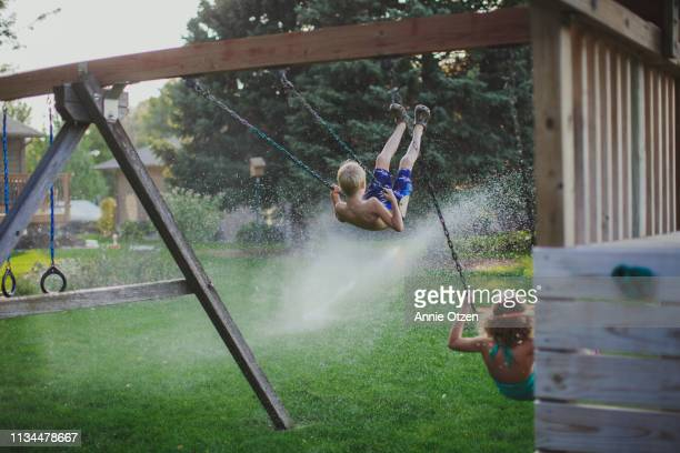 summer swing set swinging - annie sprinkle stock pictures, royalty-free photos & images