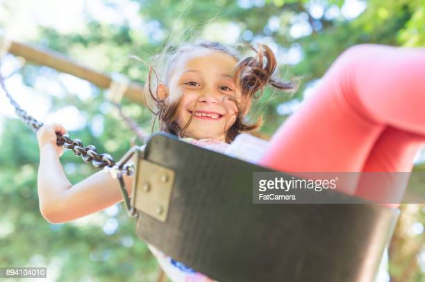 Summer Swinging at the Neighborhood Playground!