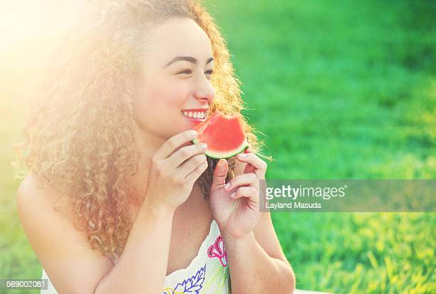 summer - teen girl eating watermelon - saturated colour stock pictures, royalty-free photos & images