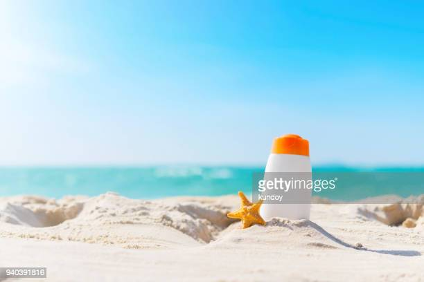 summer time on the beach with sunblock. - sunscreen stock photos and pictures