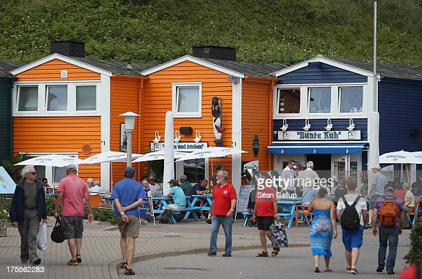 Summer tourists walk among houses built after World War II in Helgoland town on August 3 2013 on Heligoland Island Germany Heligoland Island in...