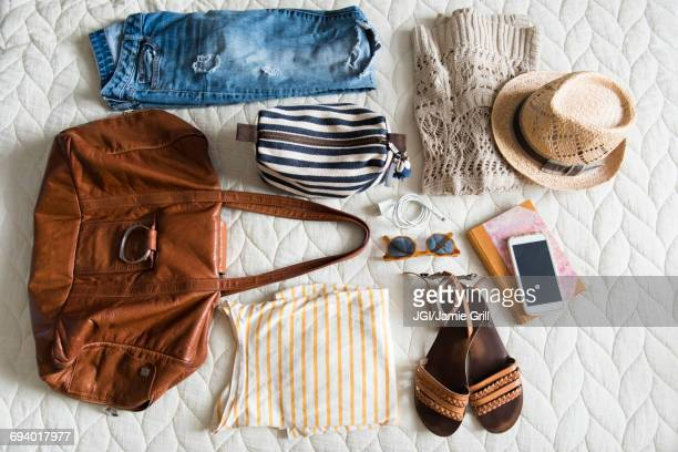 Summer travel clothing of woman on blanket