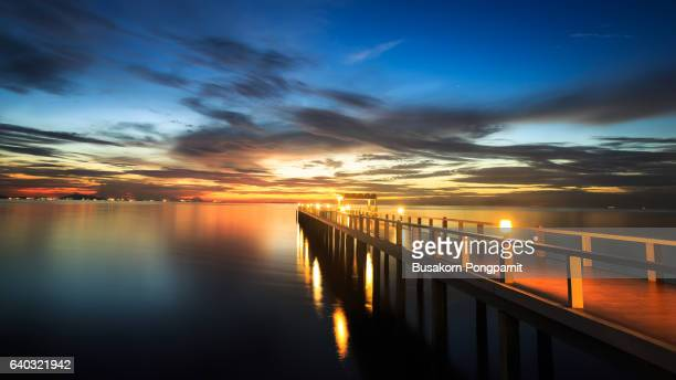 Summer, Travel, Vacation and Holiday concept - Wooden pier between sunset in Phuket