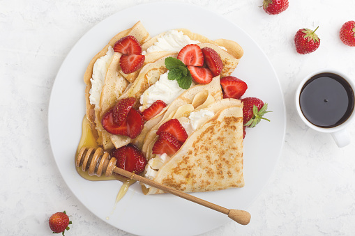 Summer treat, healthy breakfast with crepes, fresh strawberry, cheese and coffee - gettyimageskorea