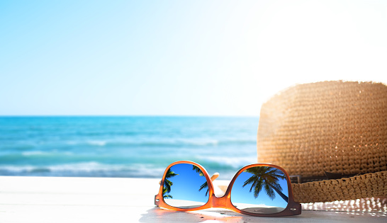 summer tropical beach background; glasses and palm tree reflex 1155508685