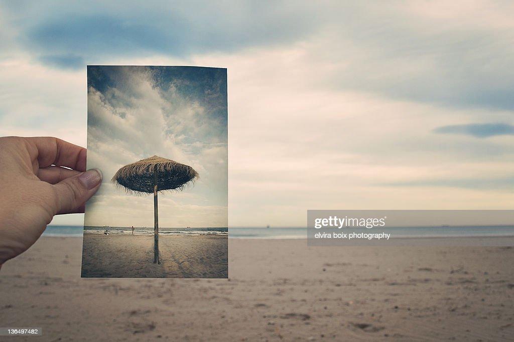 Summer umbrella in winter beach : Foto stock