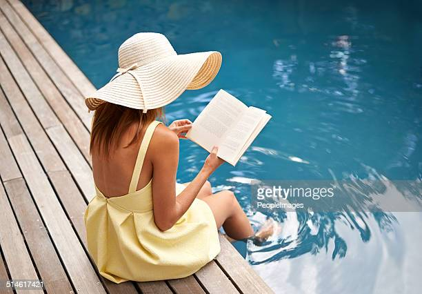 summer vacation with a great book - poolside stock pictures, royalty-free photos & images