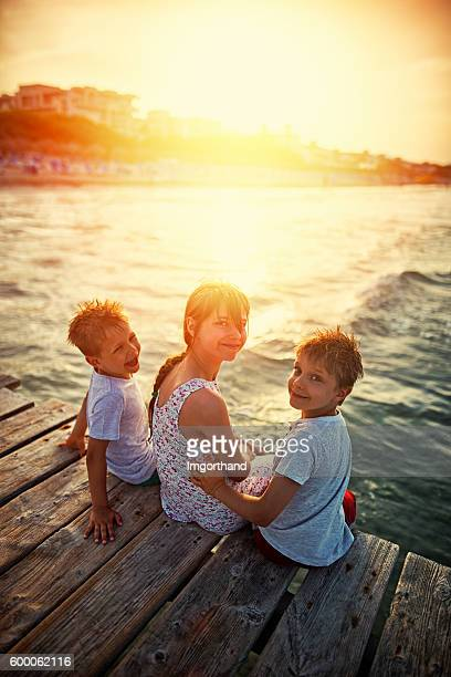 Summer vacations - happy kids on pier