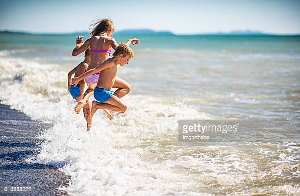Summer vacations - kids jumping into sea