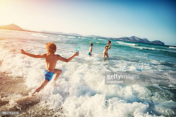 summer vacations - kids playing at sea - majorca stock pictures, royalty-free photos & images