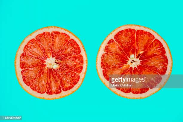 summer vibes summer theme with grapefruit halves slices - tropical fruit stock pictures, royalty-free photos & images
