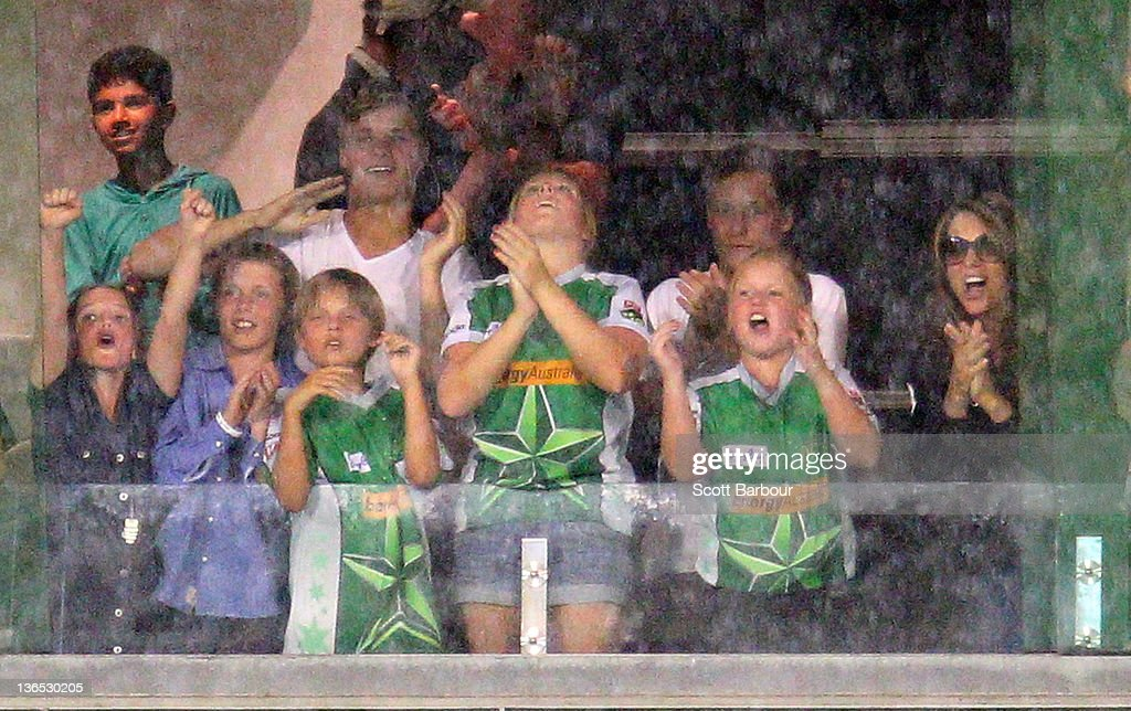 Summer Warne, Jackson Warne, Elizabeth Hurley, Damian Hurley and Brooke Warne cheer after Shane Warne of the Stars took a wicket during the T20 Big Bash League match between the Melbourne Stars and the Melbourne Renegades at the Melbourne Cricket Ground on January 7, 2012 in Melbourne, Australia.