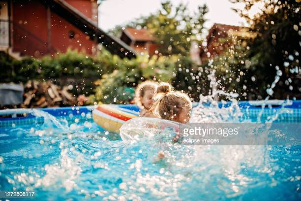 summer water games - kids pool games stock pictures, royalty-free photos & images