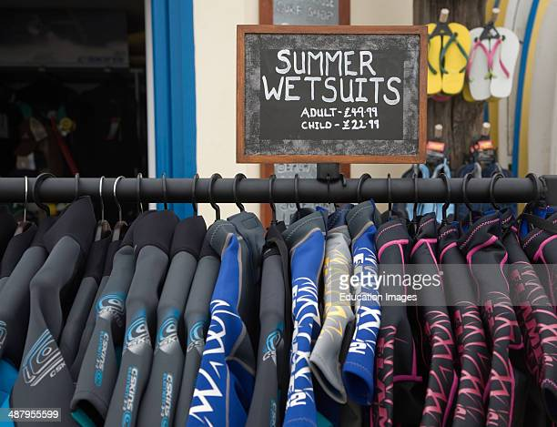 Summer wetsuits on sale at the seaside town of Cromer north Norfolk coast England