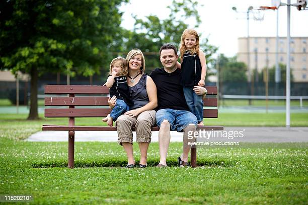 summer young nuclear family outdoors