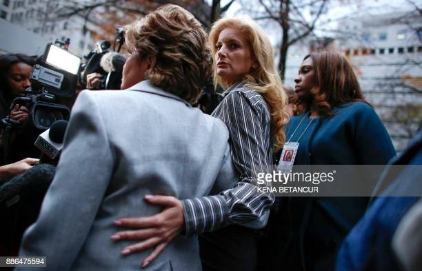 Summer Zervos a former contestant on The Apprentice looks at the camera as she embraces lawyer Gloria Allred after they leave the New York County...