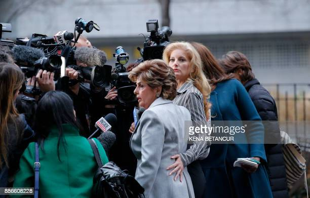 TOPSHOT Summer Zervos a former contestant on The Apprentice looks at the camera as she embraces lawyer Gloria Allred after they leave the New York...
