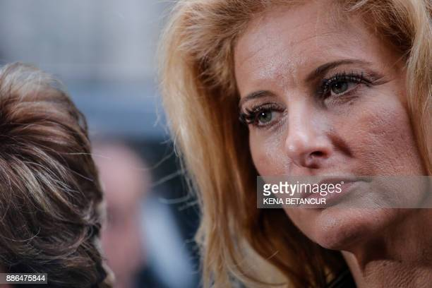 Summer Zervos a former contestant on The Apprentice looks on after leaving the New York County Criminal Court on December 5 in New York Zervos is...