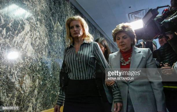 Summer Zervos a former contestant on The Apprentice walks next to lawyer Gloria Allred after they leave the New York County Criminal Court on...