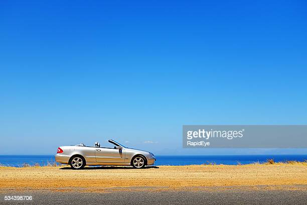 summer-blue sky and sea with parked mercedes-benz clk500 convertible - mercedes stock photos and pictures