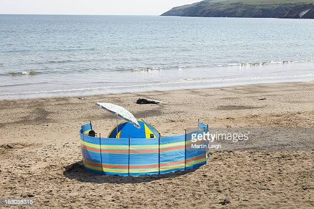summer's day at beach - windbreak stock pictures, royalty-free photos & images