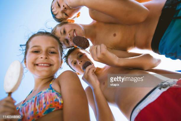summer's day with ice cream - swimwear stock pictures, royalty-free photos & images