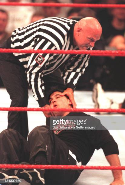 Summerslam wrestling with Gov Ventura Gov Ventura turned WWF referee picks up wrestler Shane McMahon and proceeds to throw him out of the ring