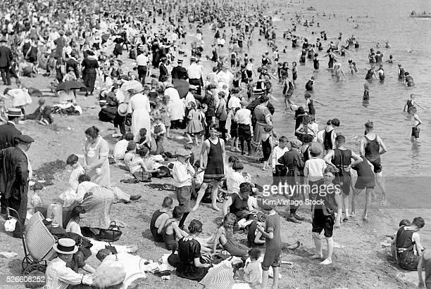 Summertime crowd gathers on an Atlantic Ocean beach.