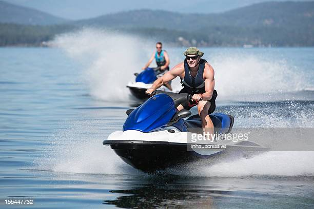 summertime fun jet skiing - jet ski stock pictures, royalty-free photos & images