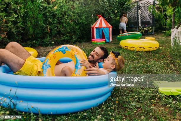 summertime in our yard - inflatable stock pictures, royalty-free photos & images