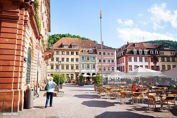 summertime scene on square marktplatz in heidelberg - heidelberg stock photos and pictures