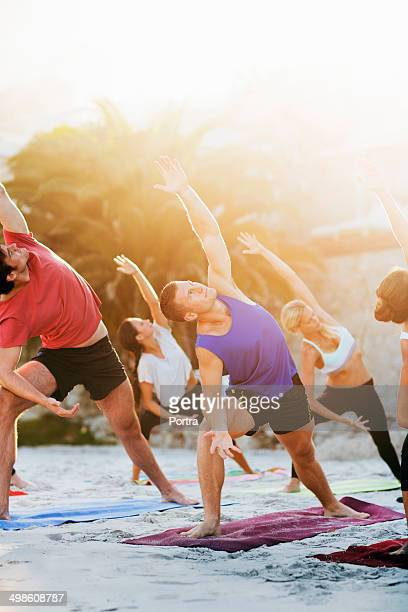 Summertime yoga class with group of people.