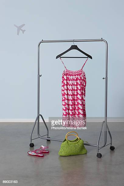 summery woman's outfit on clothes rack, plane image in background - clothes rack stock pictures, royalty-free photos & images
