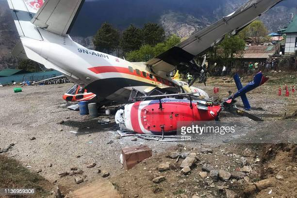 Summit Air Let L410 Turbolet aircraft bound for Kathmandu is seen after it hit two helicopters during take off at Lukla airport the main gateway to...