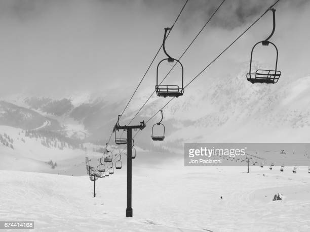 summit county, colorado - a foggy view of the norway lift at arapahoe basin ski resort on a powder day - winter sports event stock pictures, royalty-free photos & images