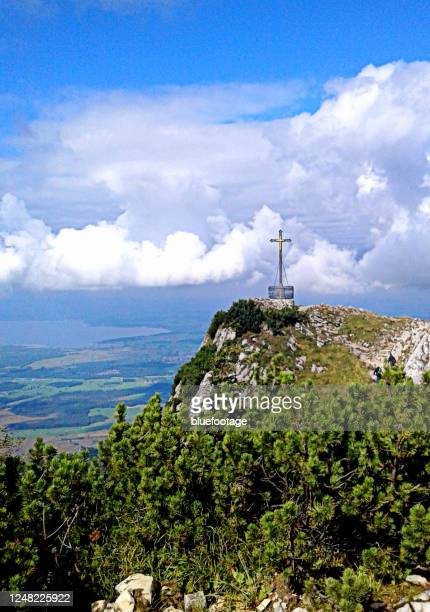 summit cross of hochfelln, bavaria, germany - bluefootage stock pictures, royalty-free photos & images